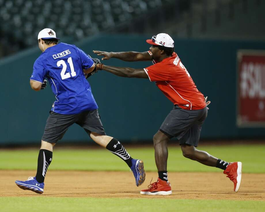 Koby Clemens runs the bases as Patrick Beverley chases him. Photo: Karen Warren, Houston Chronicle