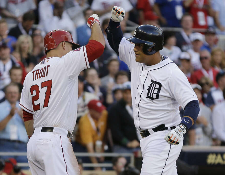 MVP Mike Trout of the Angels (left) congratulates the Tigers' Miguel Cabrera after his two-run homer in the first inning. The AL's win gave it home-field advantage in the World Series. Photo: Jeff Roberson / Associated Press / AP