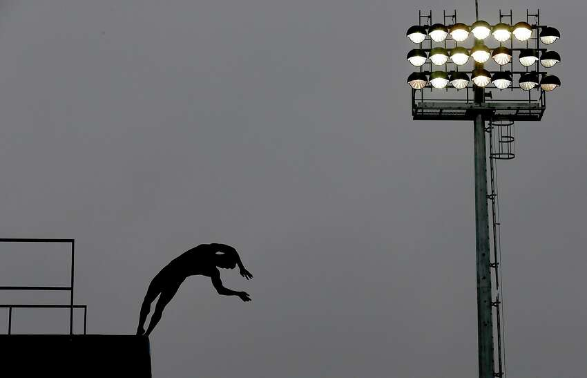 SHANGHAI, CHINA - JULY 15: Chen Aisen of China competes in the team event of the 19th FINA Diving World Cup at the Oriental Sports Center on July 15, 2014 in Shanghai, China. (Photo by Lintao Zhang/Getty Images) *** BESTPIX ***
