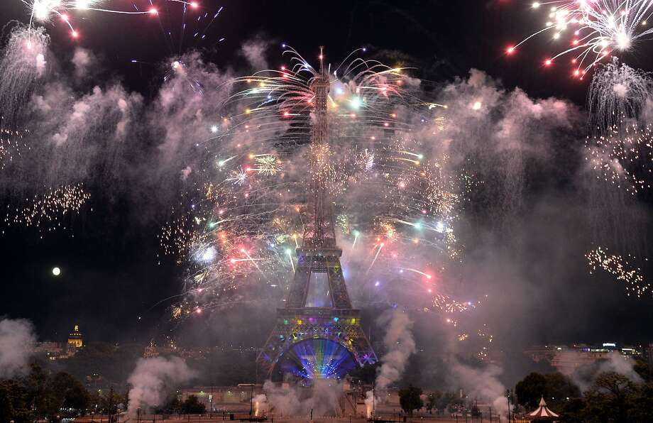 Fireworks burst around the Eiffel Tower in Paris on July 14, 2014, as part of France's annual Bastille Day celebrations. Click through the gallery to see Bastille Day specials and events happening in San Francisco. Photo: Pierre Andrieu, AFP/Getty Images