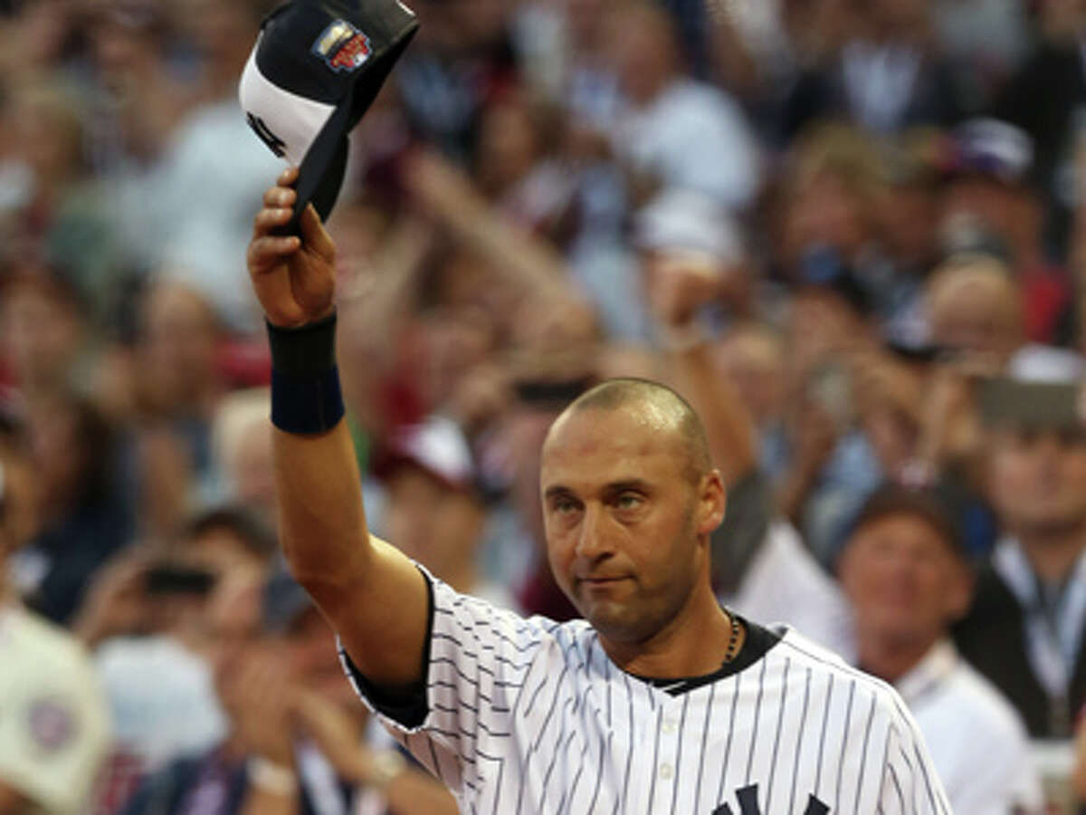 American League shortstop Derek Jeter, of the New York Yankees, waves as he is taken out of the game in the top of the fourth inning of the MLB All-Star baseball game, Tuesday, July 15, 2014, in Minneapolis.