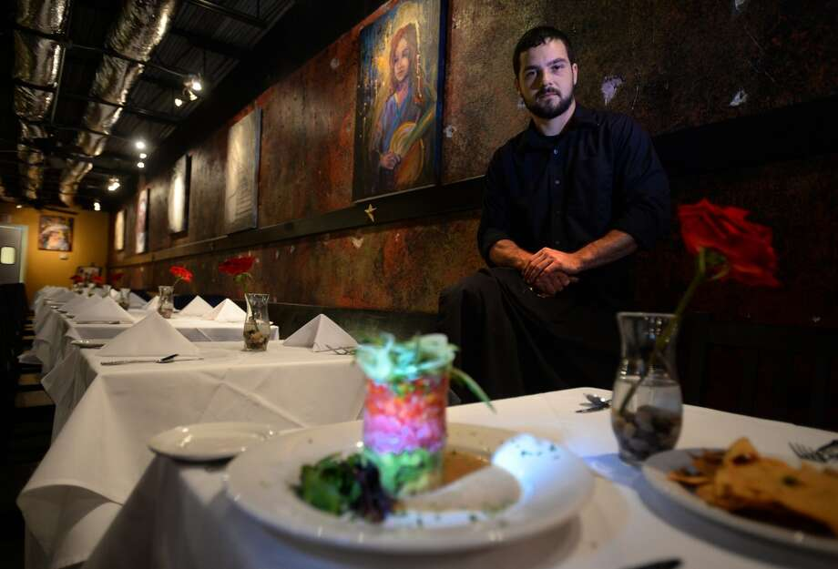 Jared Defrancis displays the Tuna tower at Finch Hutton. The Tower consists of Ahi tuna, citrus pico di gallo, avocado, julian cucumbers and topped with a Hutton vinaigrette.   Photo taken Thursday, July 03, 2014 Guiseppe Barranco/@spotnewsshooter