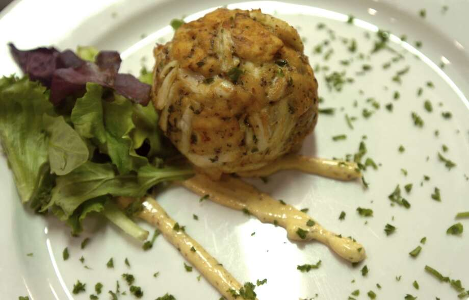 Finch Hutton offers a Jumbo Lump Crab Cake as an appetizer in Nederland, Friday, January 27, 2012. Tammy McKinley/The Enterprise