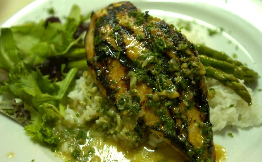 Finch Hutton offers a Grilled Chicken Breast entre' in Nederland, Friday, January 27, 2012. Tammy McKinley/The Enterprise