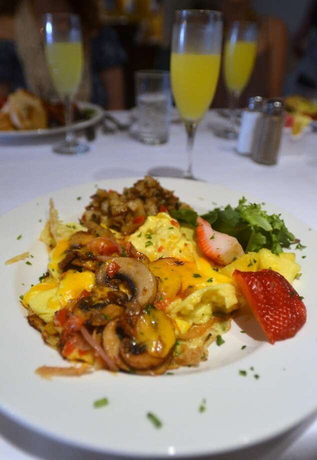 Sunday brunch at Finch Hutton in Nederland features items like the French Toast Sandwich, Harvest Crepe and mimosas. Beth Rankin/cat5