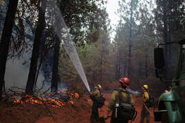 U.S. Forest Service firefighters work on the Bully Fire on Bully Choop Road near Ono, Calif, on Tuesday, July 15, 2014.