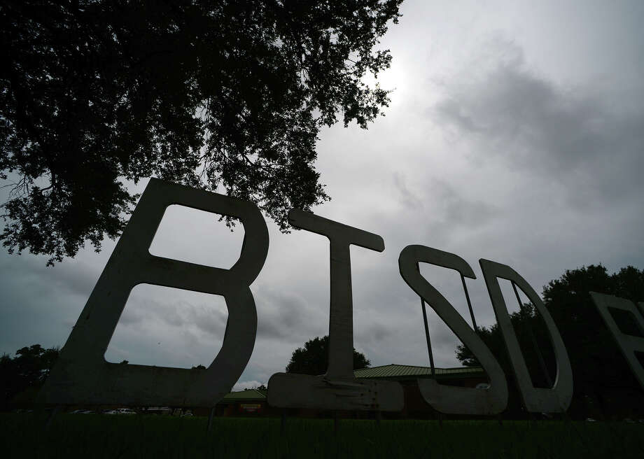 The BISD sign in front of the school district's administration building is partially silhouetted against a cloudy sky Tuesday afternoon. Photo taken Tuesday 7/15/14