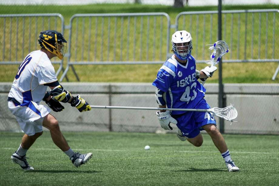 Former Westport resident and Israel's Kyle Bergman, right, looks to dodge a defender during a game against Sweden on Friday, July 11. Israel won 19-4. Photo: Gilda Haskell Rottman/Contribute / Westport News Contributed