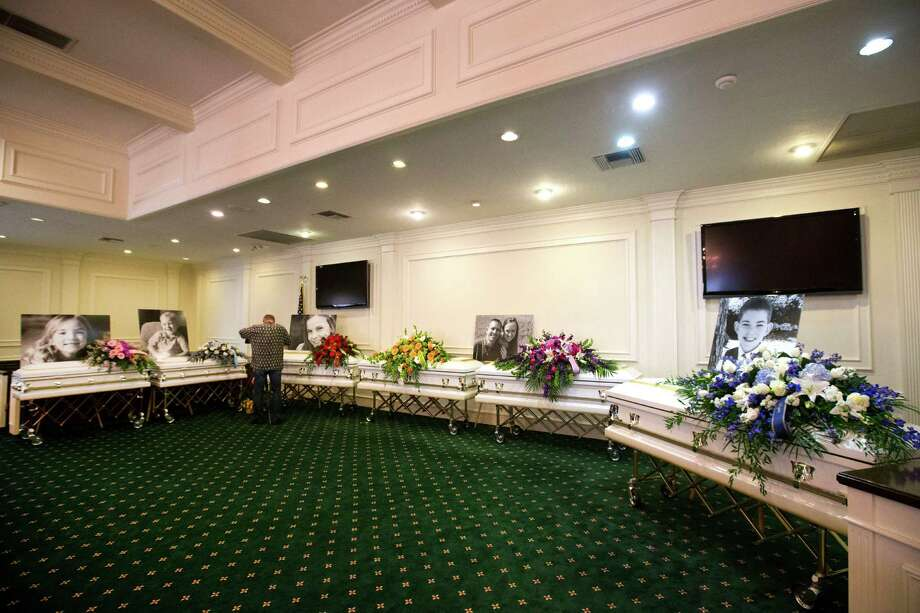 The caskets of the Stay family are placed side-by-side before visitation at Klein Funeral Home Tuesday, July 15, 2014, in Spring. Photo: Brett Coomer, Houston Chronicle / © 2014 Houston Chronicle