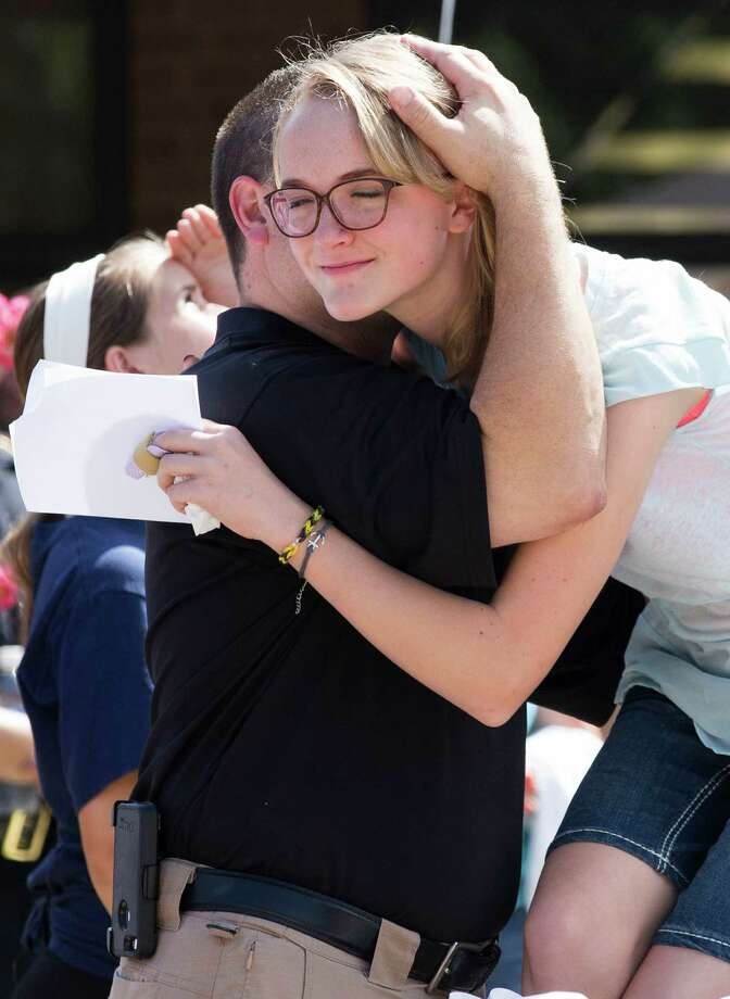 Cassidy Stay, lone survivor of the mass shooting of her parents and siblings, is embraced by Jody Dellinger during a community memorial celebrating the lives of the Stay family at Lemm Elementary School Saturday, July 12, 2014, in Spring. She is seated next to her uncle Drew Lyons. Photo: Brett Coomer, Houston Chronicle / © 2014 Houston Chronicle