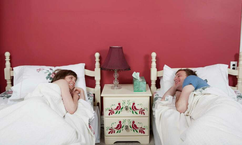 If you live with your partner, how do you sleep?