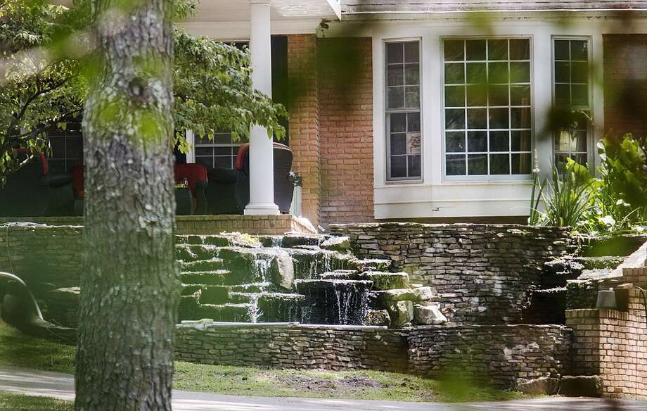 The house where bar owner Dean Riopelle overdosed Sept. 17, 2013, while at home with his girlfriend, Alix Tichelman, stands Thursday, July 10, 2014, in Milton, Ga. Two months before police say Tichelman, a high-priced prostitute, calmly left a Google executive dying from a heroin overdose on his yacht, the woman panicked on the phone with a 911 dispatcher as her boyfriend lay on the floor of their home in the throes of a fatal overdose. Police said Thursday they are re-examining the death if Riopelle, 53, the owner of a popular Atlanta music venue. Riopelle had been dating Tichelman, who is now charged with manslaughter in the November death of Google executive Forrest Hayes. She was never charged in Riopelle's death. Photo: Ron Harris, Associated Press