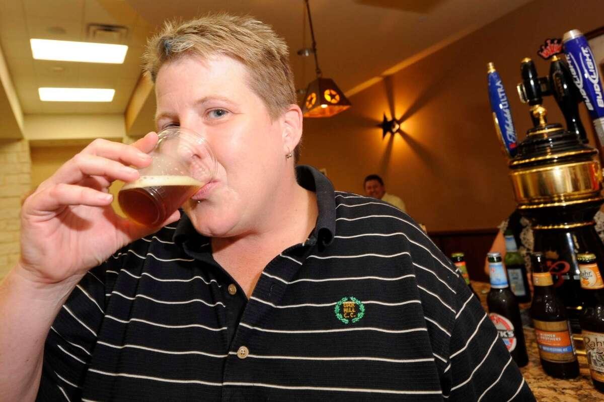 Shondi Test samples a fall craft beer during a tasting of Fall Seasonals at Del Papa. Valentino Mauricio/The Enterprise