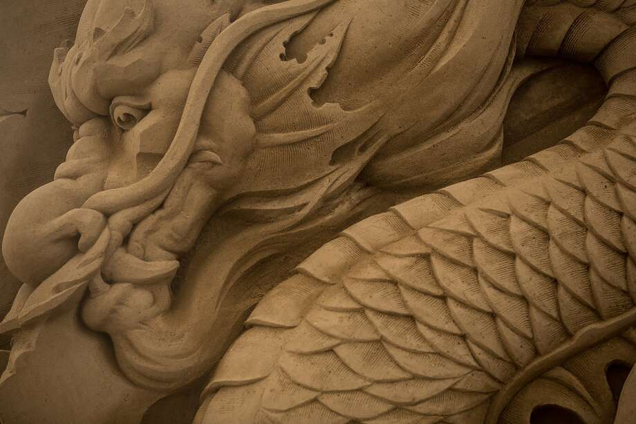 A large dragon sand sculpture is seen at the site of Yokohama Sand Art Exhibition - Culture City of East Asia 2014 on July 16, 2014 in Yokohama, Japan. Producer and sand sculptor Katsuhiko Chaen invited artists from around the world including South Korea and China, to recreate the World Heritage and historical buildings in China, Japan and South Korea. The exhibition will be open from July 19 to November 3, 2014. Photo: Chris McGrath, Getty Images
