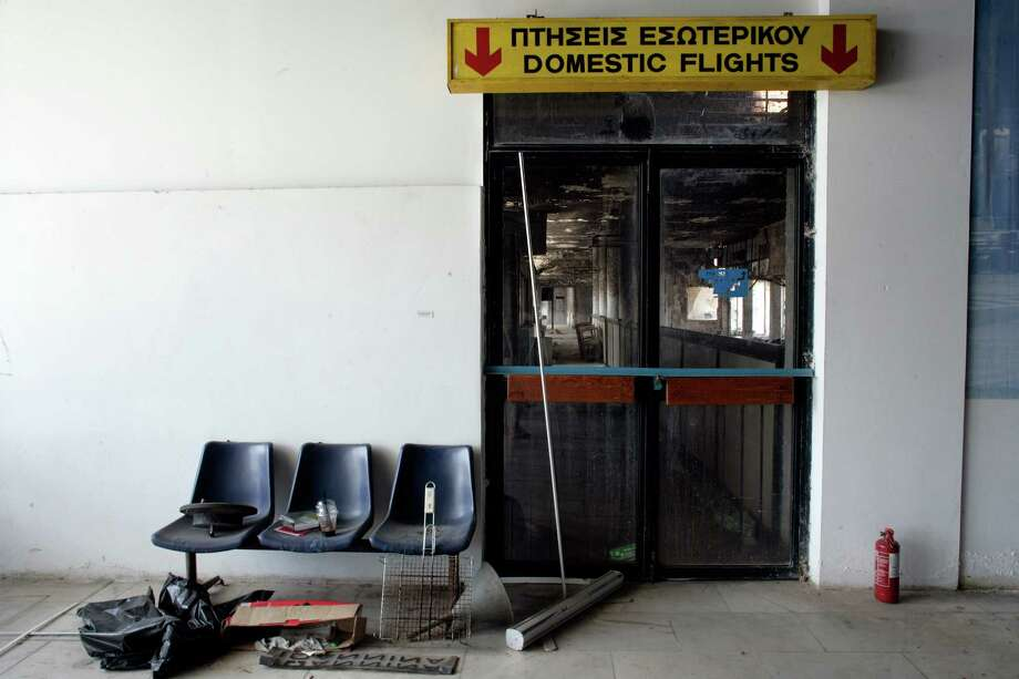 An internal view of the now abandoned Hellenikon airport on July 15th, 2014 in Athens. Hellenikon airport was built in 1938 and was Athens first and main airport serving over 12 million passengers a year. It closed in 2001 and has remained empty ever since. According to reports there are now plans to re develop the site to include hotels, shops and a marina. Photo: Milos Bicanski, Getty Images / 2014 Getty Images
