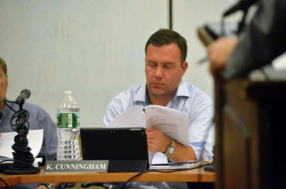 Planning and Zoning Commissioner Kevin Cunningham looked over documents pertaining to the proposed regulation change for senior housing. Photo: Megan Spicer / Darien News