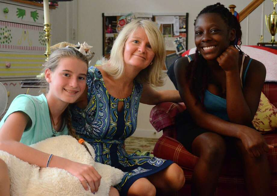 Mallory Albrecht, left, Gail Albrecht and Yahshanda Thomas at the Albrechts' residence in New Canaan, Conn., Monday, July 14, 2014. Twelve-year-old Yahshanda, a Bronx resident, has been spending two summer weeks with the family every year since 2008 as part of the Fresh Air Fund's Volunteer Host Family Program. Photo: Nelson Oliveira / New Canaan News