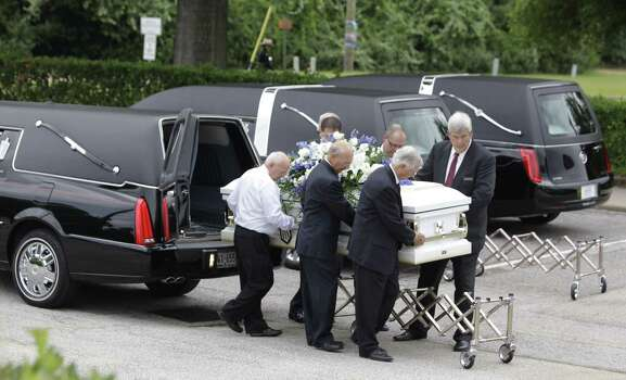 One of six caskets is carried into The Church of Jesus Christ of Latter-day Saints, 16331 Hafer Road, for the funeral service of six members of the Stay family  Wednesday, July 16, 2014. Ronald Lee Haskell is accused of killing the family members at their Spring home. Photo: Melissa Phillip / Houston Chronicle