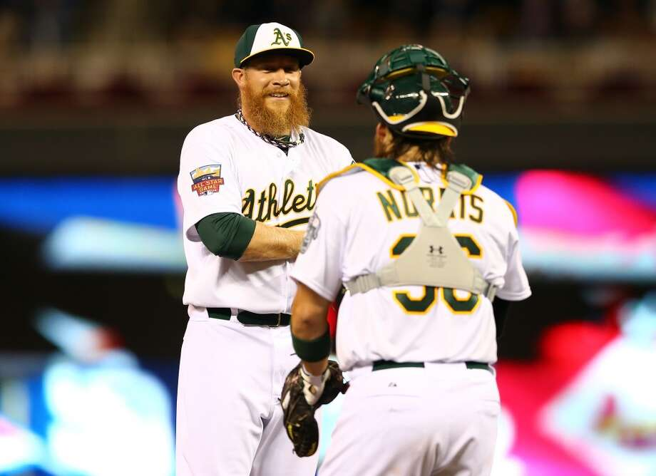 MINNEAPOLIS, MN - JULY 15: American League All-Star Sean Doolittle #62 of the Oakland Athletics speaks with teammate Star Derek Norris #36 against the National League All-Stars during the 85th MLB All-Star Game at Target Field on July 15, 2014 in Minneapolis, Minnesota.  (Photo by Elsa/Getty Images) Photo: Getty Images