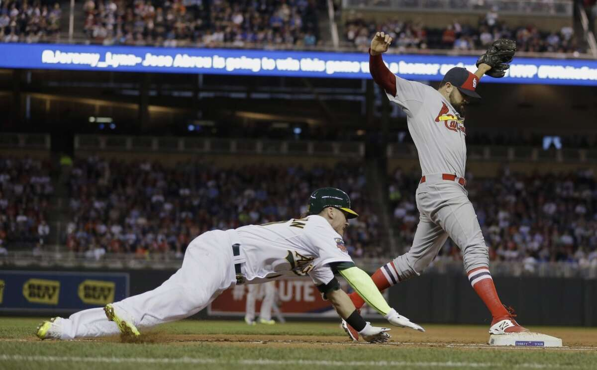 National League pitcher Pat Neshek, of the St. Louis Cardinals, right, forces out American League's Josh Donaldson, of the Oakland Athletics, at first base during the fifth inning of the MLB All-Star baseball game, Tuesday, July 15, 2014, in Minneapolis. (AP Photo/Jeff Roberson)