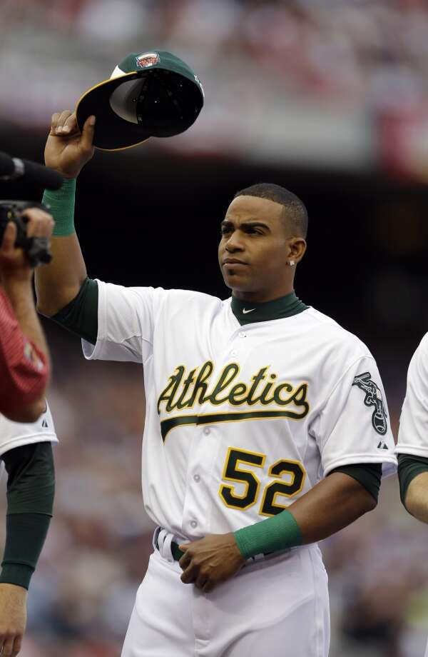 American League outfielder Yoenis Cespedes, of the Oakland Athletics, waves to the crowd before the MLB All-Star baseball game, Tuesday, July 15, 2014, in Minneapolis. (AP Photo/Jeff Roberson) Photo: Associated Press
