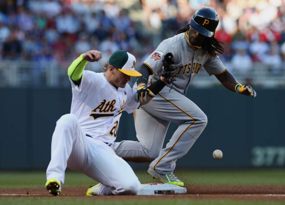National League outfielder Andrew McCutchen, of the Pittsburgh Pirates, steals third base as American League Josh Donaldson, of the Oakland Athletics, tries to make the tag during the first inning of the MLB All-Star baseball game, Tuesday, July 15, 2014, in Minneapolis. (AP Photo/Jim Mone) Photo: Associated Press