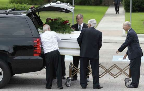 One of six caskets are carried into The Church of Jesus Christ of Latter-day Saints,16331 Hafer Road, for the funeral of six members of the Stay family Wednesday, July 16, 2014. Photo: Melissa Phillip / Houston Chronicle