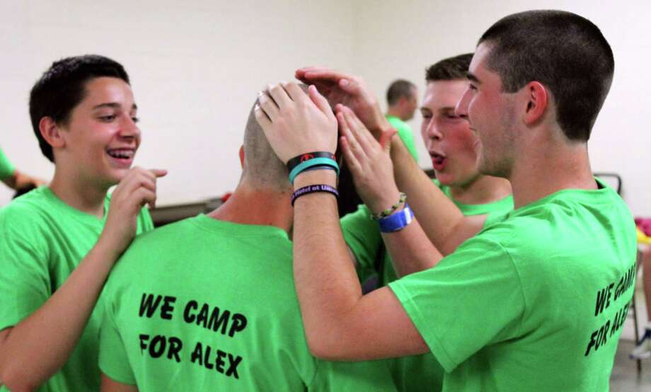 Members of Boy Scout Troop 9 Stamford get their hair cut in solidarity with Alex Huntoon, who was recently diagnosed with Burkitt's lymphoma. The event took place Thursday, July 10, 2014 at First United Methodist Church in Stamford, Conn. Photo: John Breunig / Stamford Advocate