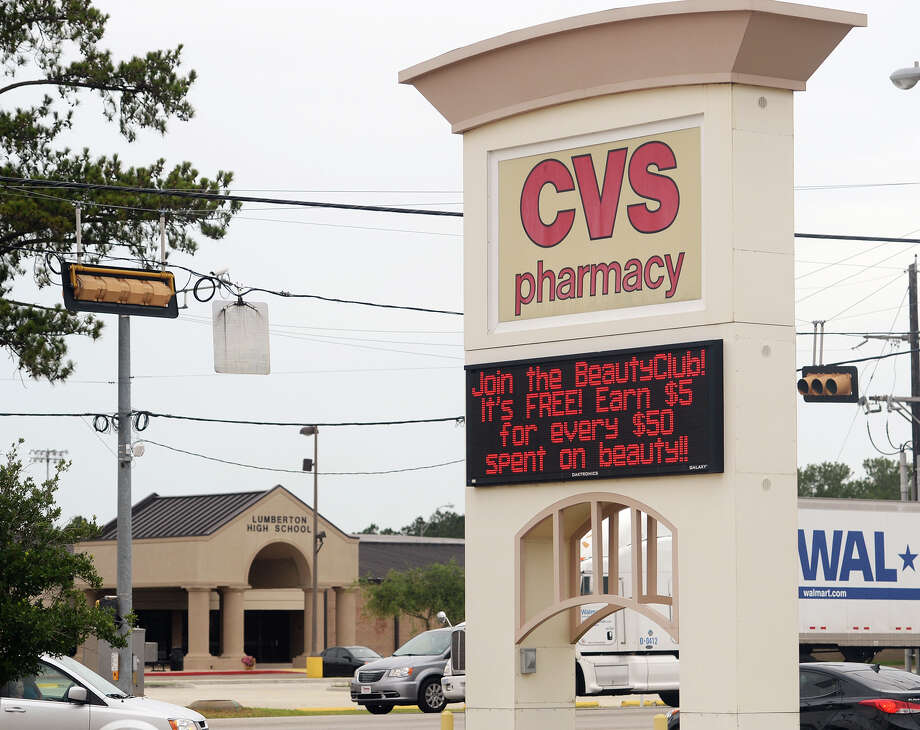 Traffic passes between Lumberton High School and a CVS store Tuesday afternoon. The CVS in Lumberton has secured the city's permission to sell alcohol within 300 feet of a school zone, meaning the store on South LHS Drive across the street from Lumberton High School may begin to see beer and wine soon. Photo taken Tuesday 7/15/14 Jake Daniels/@JakeD_in_SETX Photo: Jake Daniels / ©2014 The Beaumont Enterprise/Jake Daniels