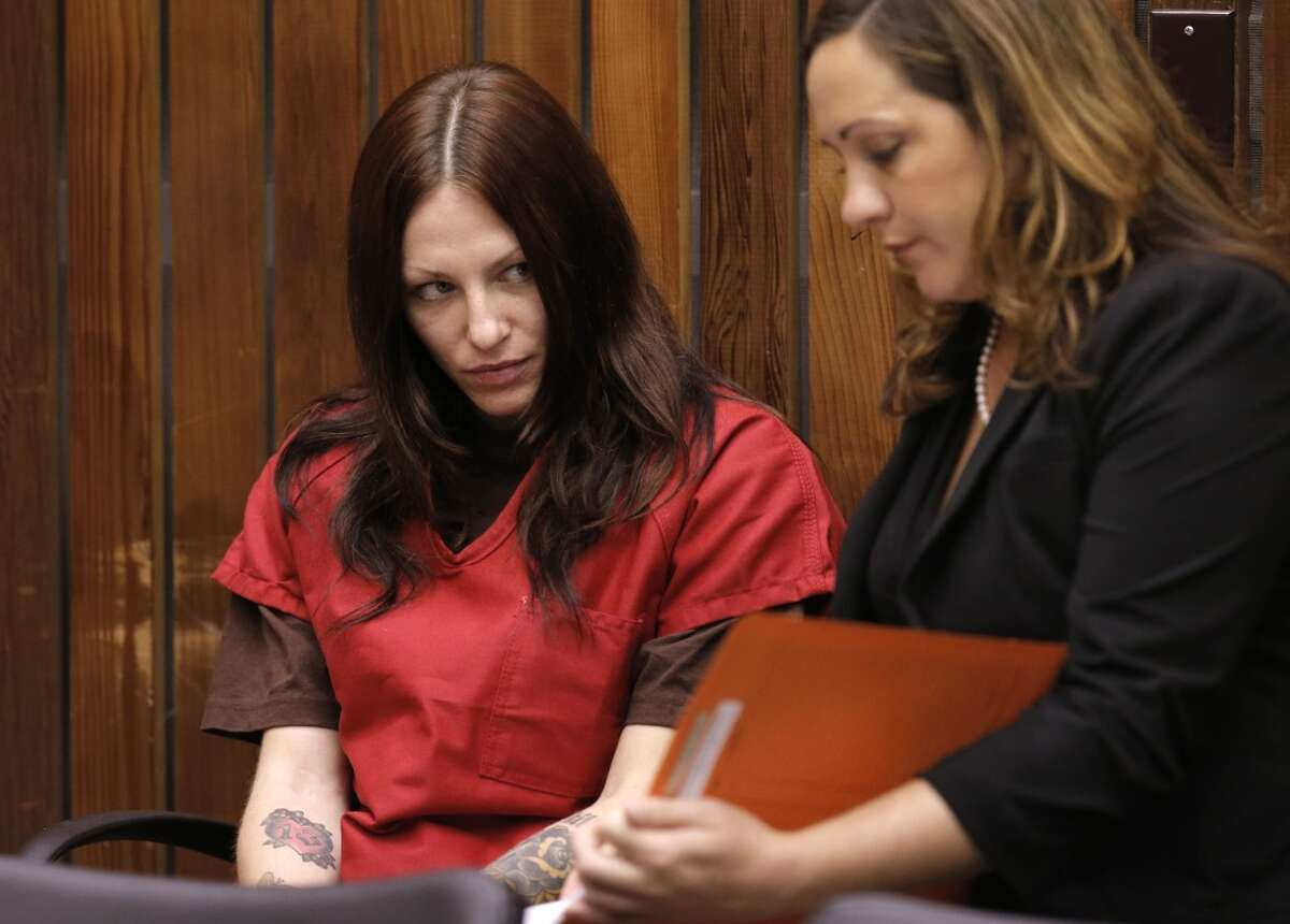 Alix Tichelman, left, with her attorney Athena Reis during her arraignment by Judge Timothy Volkman, in Santa Cruz Co. Superior court on Wednesday July 16, 2014, in Santa Cruz, Calif.