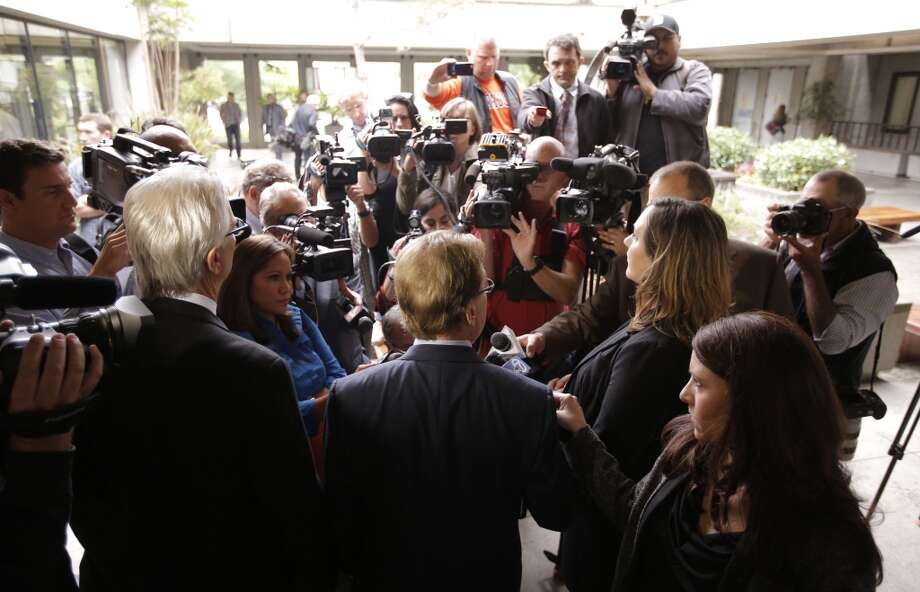 Attorneys Jerry Christensen, Larry Biggam and Athena Reis speak with the media following the arraignment for their client manslaughter suspect Alix Tichelman by Judge Timothy Volkman, in Santa Cruz Co. Superior court on Wednesday July 16, 2014,  in Santa Cruz, Calif. Photo: Michael Macor, The Chronicle