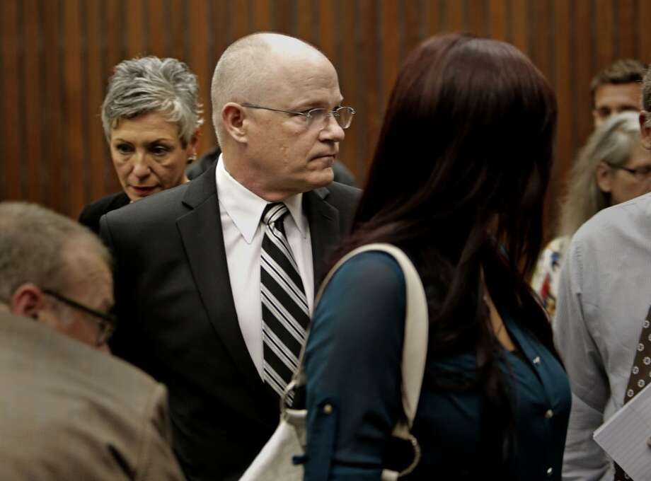 Family members of manslaughter suspect Alix Tichelman, Leslie, (mother) and Bart (father) Tichelman leaving the courtroom after  the arraignment by Judge Timothy Volkman, in Santa Cruz Co. Superior court on Wednesday July 16, 2014, in Santa Cruz, Calif. Photo: Michael Macor, The Chronicle