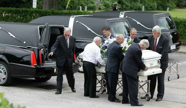 One of six caskets are carried into The Church of Jesus Christ of Latter-day Saints ,16331 Hafer Road, for the funeral service of six members of the Stay family  Wednesday, July 16, 2014. Photo: Melissa Phillip, Houston Chronicle / © 2014  Houston Chronicle
