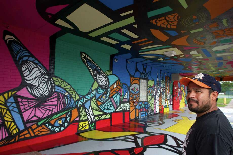 Muralist Daniel Anguilu is painting the Altharetta Yeargin Art Museum -- until now, a hidden gem on the campus of Spring Branch ISD's Westchester campus. Photo: J. Patric Schneider, For The Chronicle / © 2014 Houston Chronicle