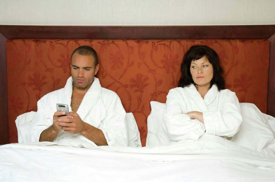 25 percent would rather go without sex than their smartphone. Meanwhile, 1 in 10 people nationwide said they've used their phone during sex, according to a 2013 survey conducted by pollsters Harris Interactive. Photo: Getty Images/Compassionate Eye Foundation / (c) Compassionate Eye Foundation