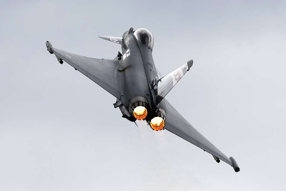 A Eurofighter Typhoon flies on display during Farnborough International Air Show, Farnborough, England, Wednesday, July 16, 2014. Photo: Sang Tan, Associated Press