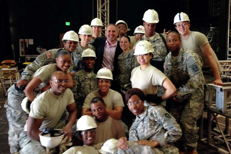 Steve Sellery, wearing a suit in the middle, stand with some of the Army entertainment crew at Fort Sam Houston Theatre at Joint Base Fort Sam Houston, San Antonio, Texas. Photo: Contributed Photo, Contributed / Darien News Contributed