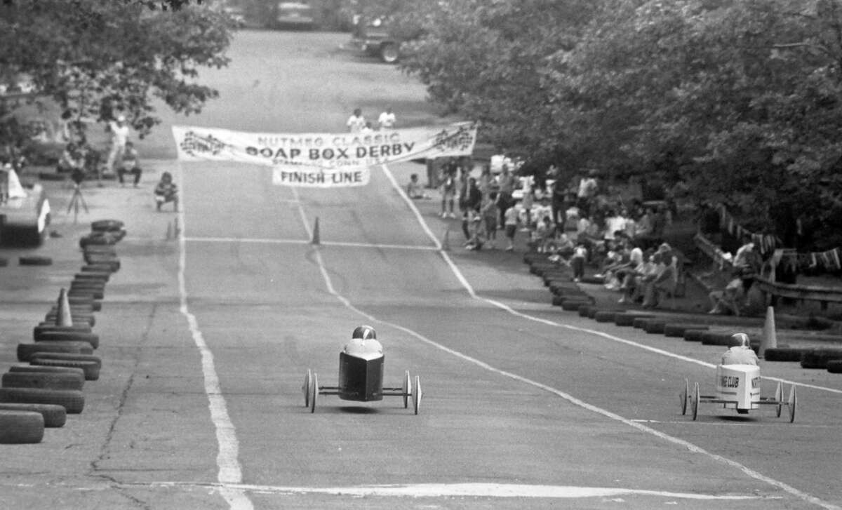 Racers compete in the 6th annual Southern Connecticut Nutmeg Classic Soap Box Derby at Rippowam Center on July 22, 1989. Racers from Stamford, Norwalk, Bridgeport and girls from Scotland and France competed in the event.