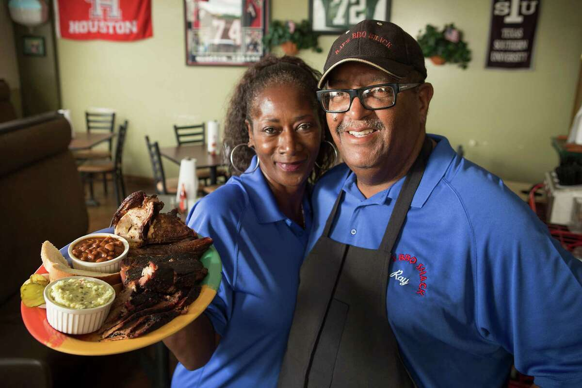 Maxine Davis, left, and Ray Busch, owners of Ray's BBQ Shack, pose for a portrait with the House Special.