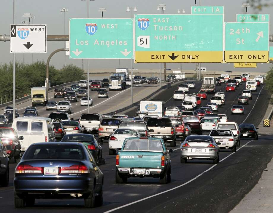 Phoenix, Arizona     Summer temperature in 2014: 103.96 F  Summer temperature in 2100: 114.08 F Photo: Jeff Topping, Getty Images