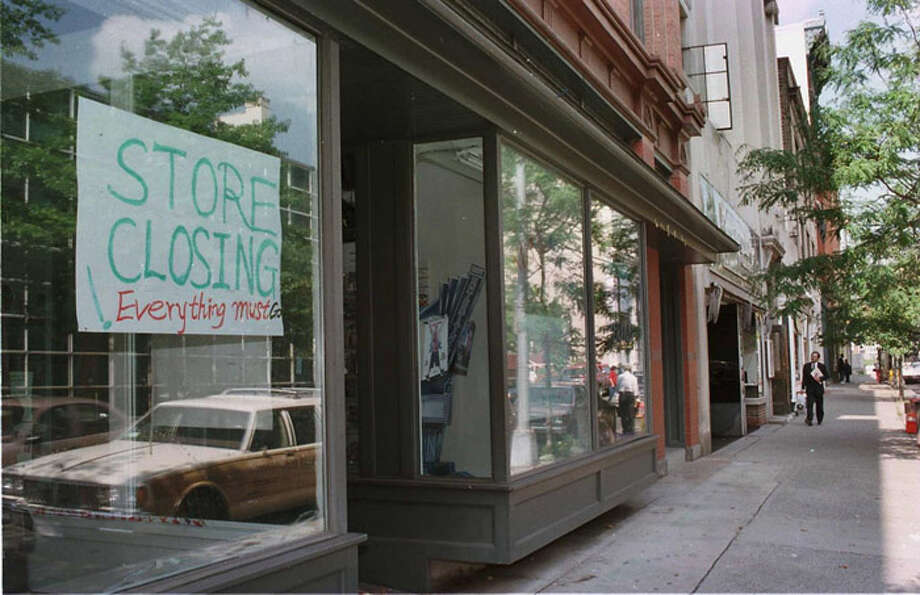 Times union photo by  LUANNE M. FERRIS -- FRIDAY SEPT. 12, 1997, TROY THIRD ST. BETWEEN FULTON AND BROADWAY.  FOLLOW TO LAST YRS. STORY ON WHAT THE INFLUX OF STATE WORKERS, AND WHAT IT MIGHT TO THE DOWNTOWN ECONOMY.  ONE OF THE BUILDINGS HAS A GOING OUT OF BIZ SIGN. Photo: LUANNE M. FERRIS, 518Life / ALBANY TIMES UNION