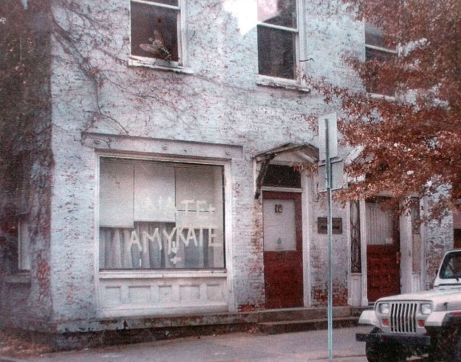 "Times Union Photo by James Goolsby-May 9, 2004-A before photo,  of the exterior of 12 State St. In Troy. The building was built in 1810. The building is being restored by the owner, Carl Erickson. He wants to turn the building into office space. The building is part of the ""This Old House Museum & Preservation Fair"". Sponsered by the Rensselaer County  Historical Society. Photo: JAMES GOOLSBY / ALBANY TIMES UNION"