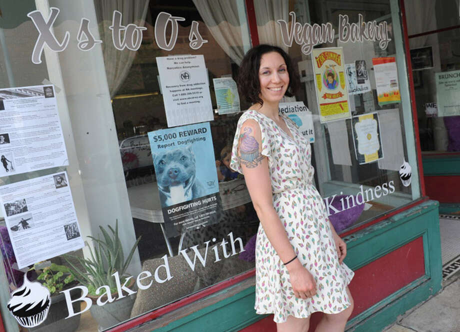Sarah Preston, owner of X's to O's Vegan Bakery, stands outside her restaurant at 97 4th St. on Thursday, Aug. 8, 2013 in Troy, N.Y. (Lori Van Buren / Times Union) Photo: Lori Van Buren / 00023451A