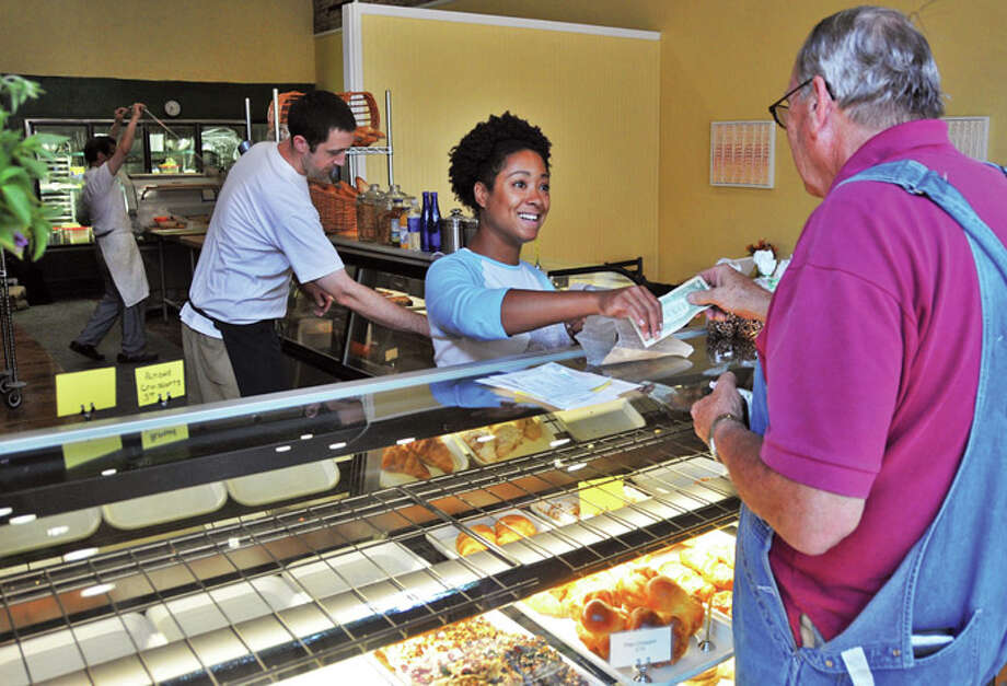 Tonya Abernathy,center, works the counter at The Placid Baker on Broadway in downtown Troy Thursday morning July 23, 2009.   (John Carl D'Annibale / Times Union) Photo: John Carl D'Annibale / 00004818A