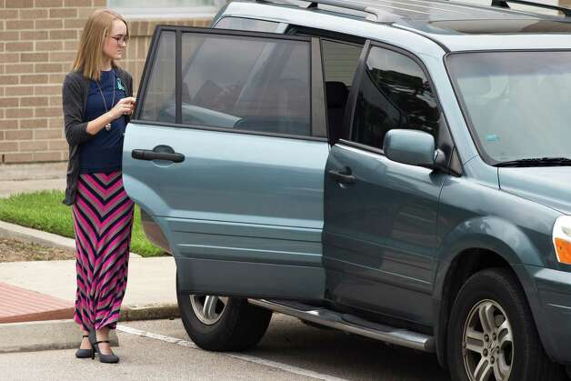 Cassidy Stay arrives to The Church of Jesus Christ of Latter-day Saints for the funeral services of six members of her family Wednesday, July 16, 2014, in Houston. Ronald Lee Haskell is accused of killing the family members at t