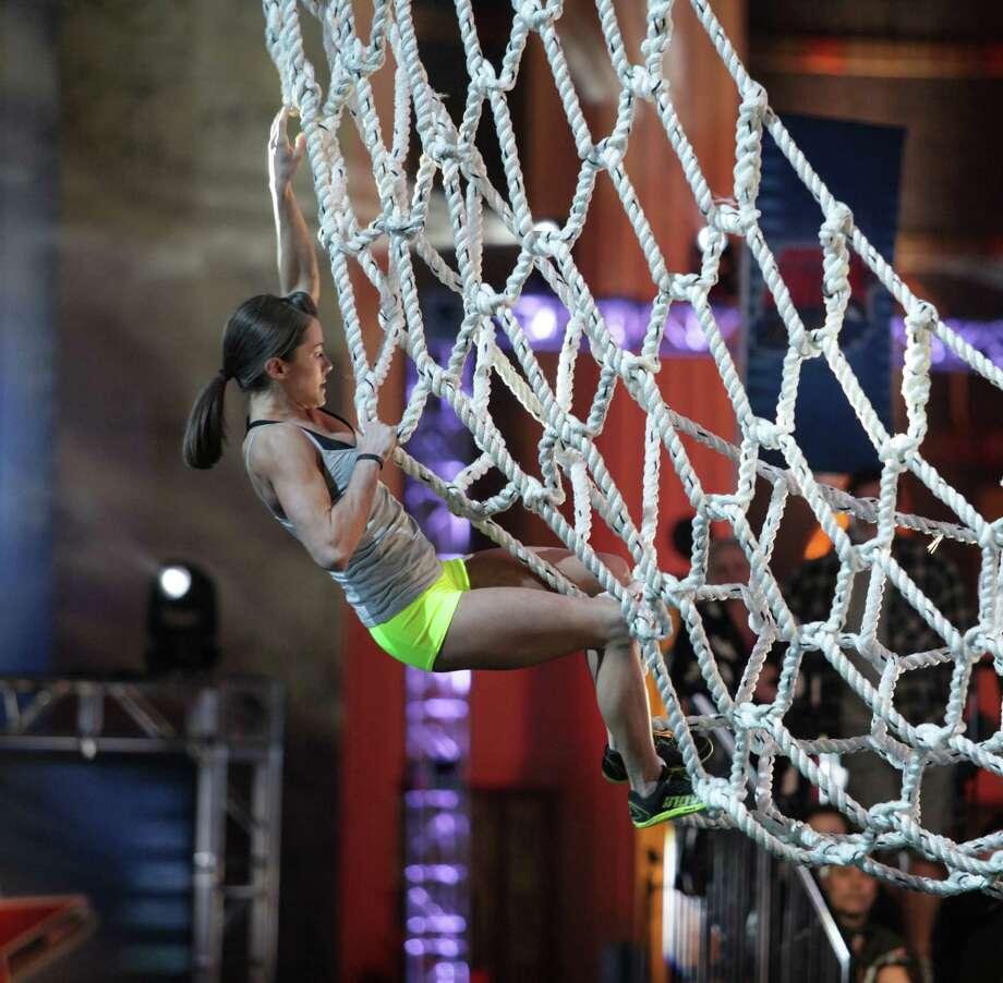 "San Antonio's Kacy Catanzaro competes on ""American Ninja Warrior"" on NBC. Photo: Esquire Network, NBCU Photo Bank Via Getty Images / 2014 NBCUniversal Media, LLC"