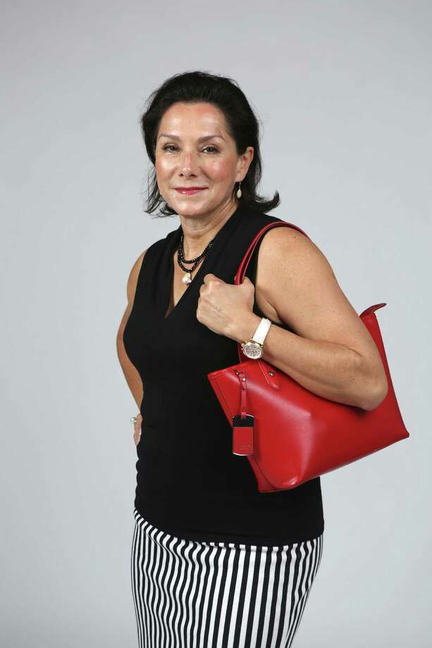 JoAnn Boone president and CEO of Rio San Antonio Cruises, shows off what is in her bag. Photo: San Antonio Express-News / ©2014 San Antonio Express-News