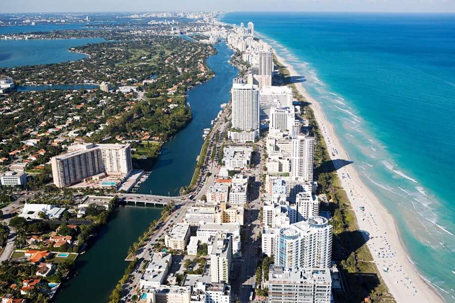 MiamiSummer temperature in 2014:88.56 F  Summer temperature in 2100: 94.87 F Photo: Image Source, Getty Images/Image Source