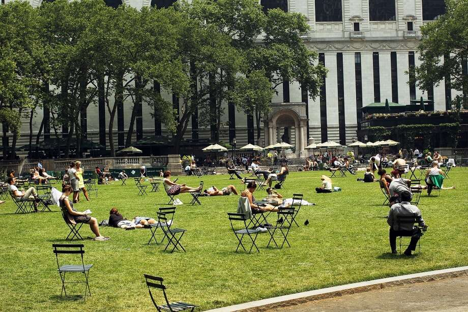 New York City  Summer temperature in 2014: 82.38 F  Summer temperature in 2100: 91.76 F Photo: Spencer Platt, Getty Images