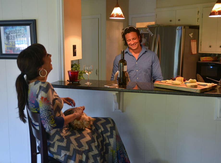 Luca Della Casa and his wife, Marcella, enjoy their Monday evening at home while Luca prepares dinner. Photo: Robin Jerstad / For The Express-News